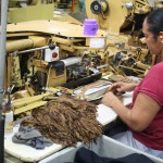 Applying the wrapper to machine made cigars