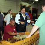 Anthony has a test blend rolled while Michael Gianni from La Gloria Cubana looks on.